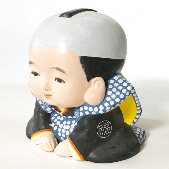 とても表情のいい、古い福助人形
