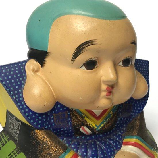 貯金箱になっている、大きな古い陶器の福助人形