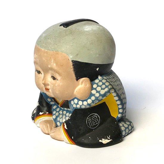 古い陶器の福助人形。センスのいい陣羽織が特徴的です。