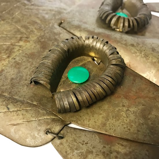 メキシコの街タスコで作られた古いブリキのお面