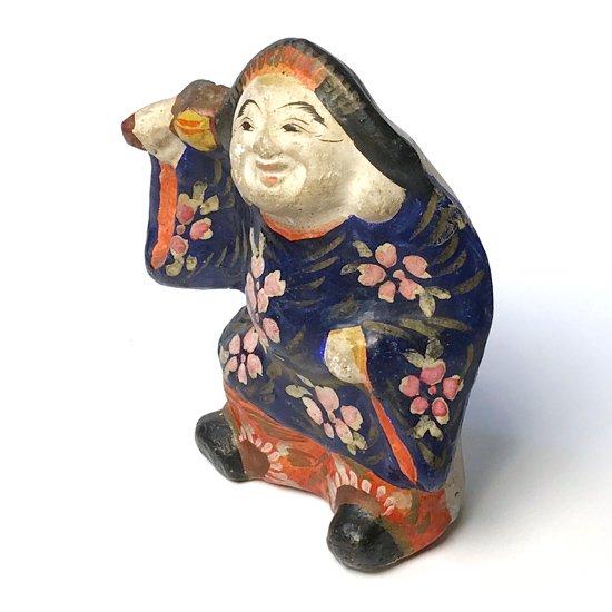 色使いと絵付けの雰囲気がとても良い花巻人形の大黒さま