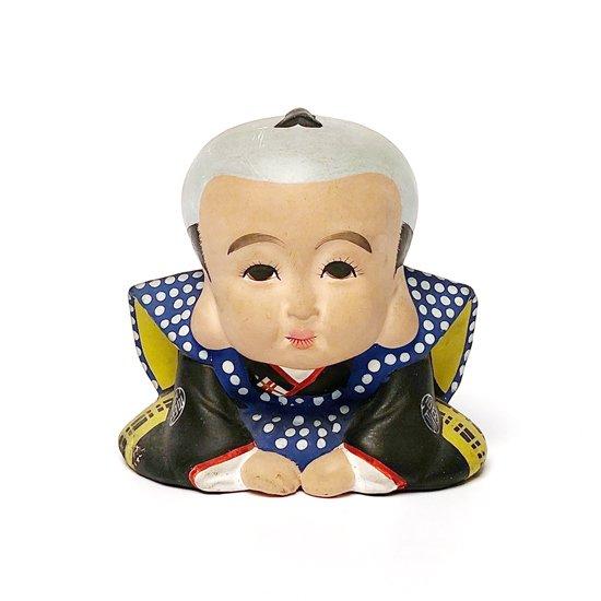 顔つきや羽織の柄など作りの良い、古い福助人形