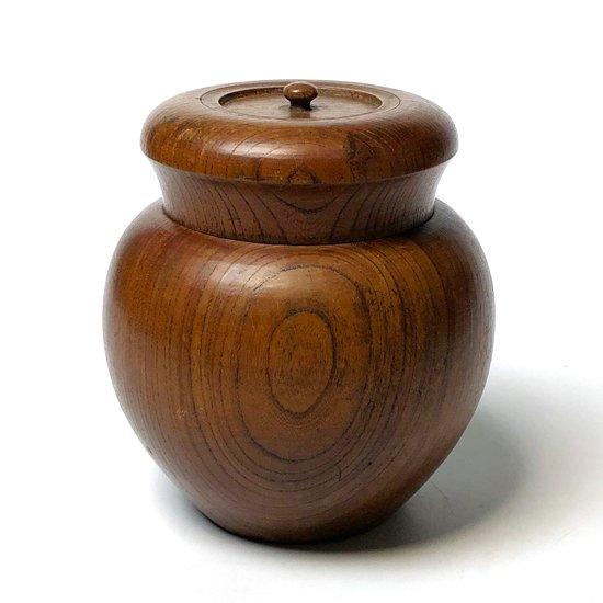 欅材をロクロで挽いて造形をした古い拭き漆の茶入れ