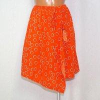 ラップスカート風のオーバースカート リングドット オレンジ