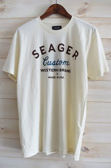 <img class='new_mark_img1' src='https://img.shop-pro.jp/img/new/icons14.gif' style='border:none;display:inline;margin:0px;padding:0px;width:auto;' />SEAGER BADLANDS TEE シーガー Tシャツ CREAM