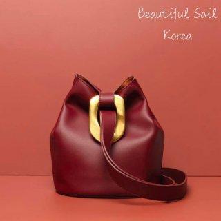 【大特価】3色展開 レッド ブラック ホワイト レザー 本革 メタルモチーフ ゴールドメタル ドローストリングバッグ